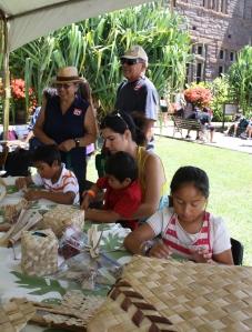 Keiki weaving lauhala at the Grow Hawaiian Festival